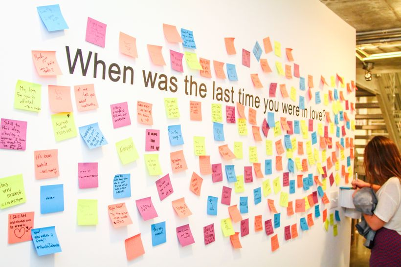 Upon walking in the Love Lost exhibition attendees are asked to write on Post-it notes when was the last time they were in lo