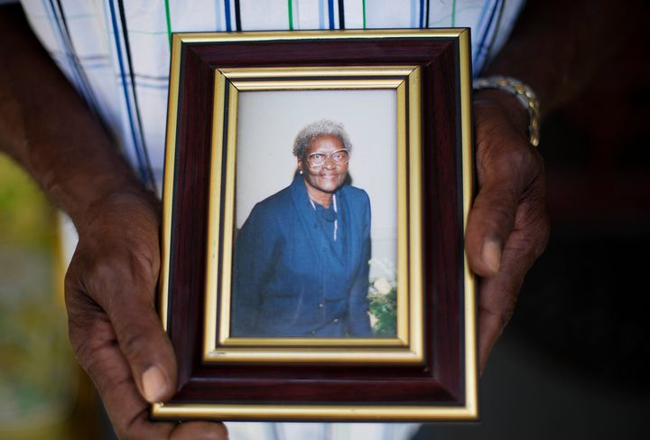 Walter Jackson holds a photo of his mother, Susie, one of the nine people killed in the June 17, 2015, shooting at Emanu