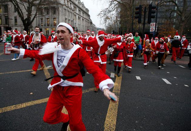 Santas take part in the Santacon event in