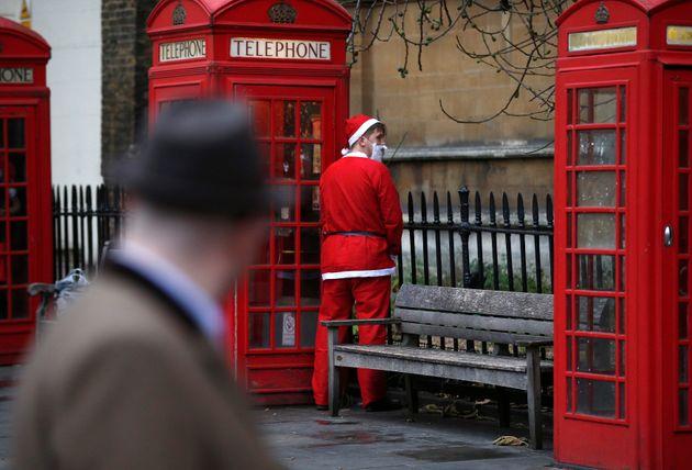 Man dressed as Santa Claus relieves