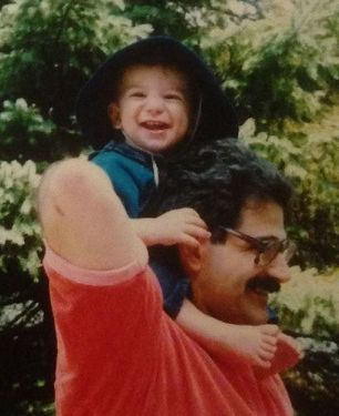 Pictured: Me, my already huge feet, and one smiley father.