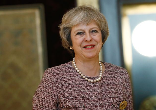 May was criticised after she was photographed wearing £1,000 leather