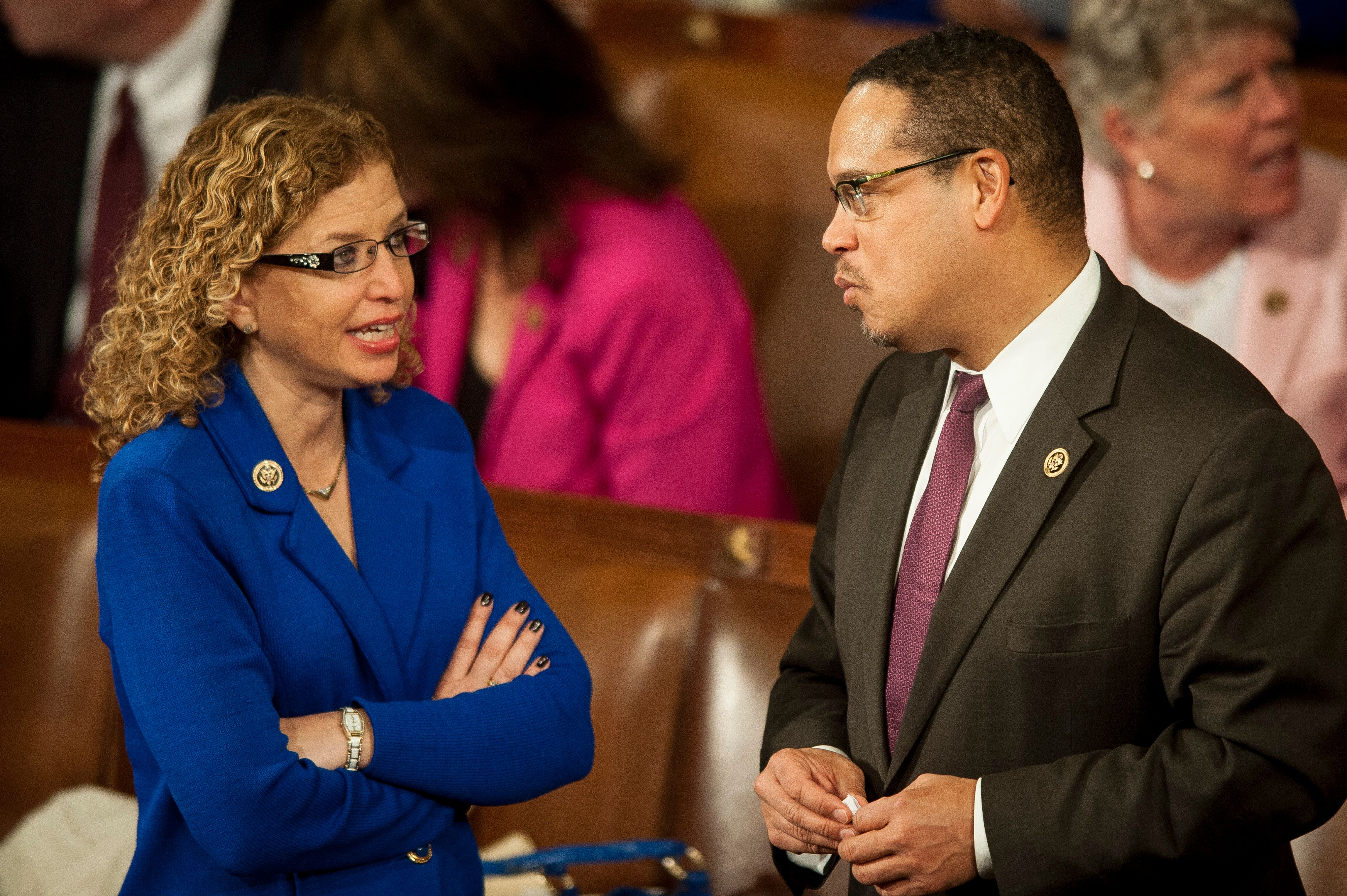 Representative Debbie Wasserman Schultz, a Democrat from Florida, left, talks with Representative Keith Ellison, a Democrat from Minnesota, before U.S. President Barack Obama delivers the State of the Union address to a joint session of Congress at the Capitol in Washington, D.C., U.S., on Tuesday, Jan. 20, 2015. Obama declared the U.S. economy healed and said the nation now must begin work to close the gap between the well-off and the wanting. Photographer: Pete Marovich/Bloomberg via Getty Images