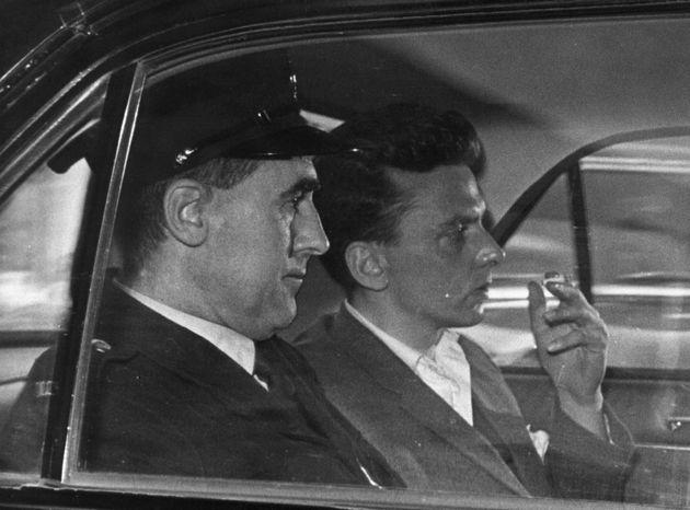 Ian Brady being taken to court by car in