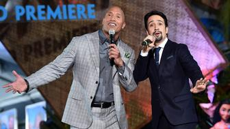 HOLLYWOOD, CA - NOVEMBER 14:  Actor Dwayne Johnson (L) and songwriter Lin-Manuel Miranda perform onstage at The World Premiere of Disney's 'MOANA' at the El Capitan Theatre on Monday, November 14, 2016 in Hollywood, CA.  (Photo by Alberto E. Rodriguez/Getty Images for Disney)