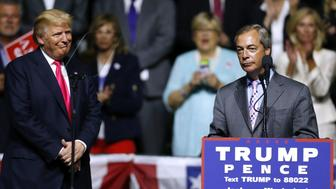 JACKSON, MS - AUGUST 24: Republican Presidential nominee Donald Trump, left,  listens to United Kingdom Independence Party leader Nigel Farage speak during a campaign rally at the Mississippi Coliseum on August 24, 2016 in Jackson, Mississippi. Thousands attended to listen to Trump's address in the traditionally conservative state of Mississippi. (Photo by Jonathan Bachman/Getty Images)