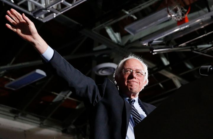 Democratic U.S. presidential candidate Bernie Sanders waves after winning at his 2016 New Hampshire presidential primary nigh