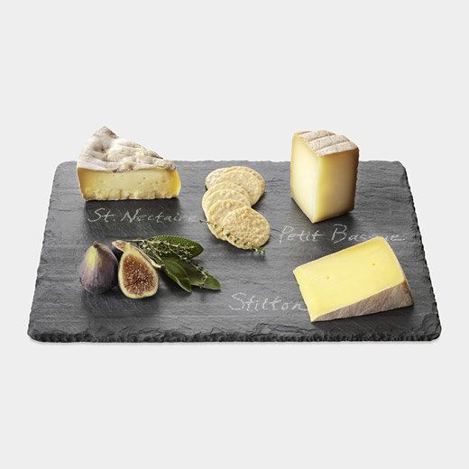 A slate cheese board is a great gift because it allows the host to specify which cheesesare being served. Wood cheese b