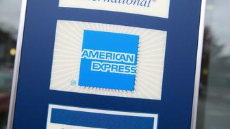 DES PLAINES, IL - NOVEMBER 11:  A sign showing the American Express logo is seen outside of a bank November 11, 2008 in Des Plaines, Illinois. American Express won federal approval to become a bank holding company which could cut its borrowing costs and allow access to government money.  (Photo by Justin Sullivan/Getty Images)