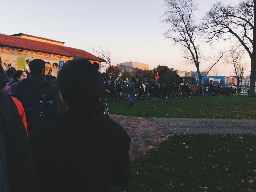 """Students march urging administration to mark Oberlin College as a """"sanctuary campus."""""""