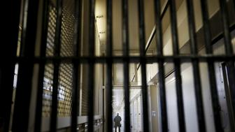 A guard stands behind bars at the Adjustment Center during a media tour of California's Death Row at San Quentin State Prison in San Quentin, California December 29, 2015. Picture taken December 29, 2015. REUTERS/Stephen Lam