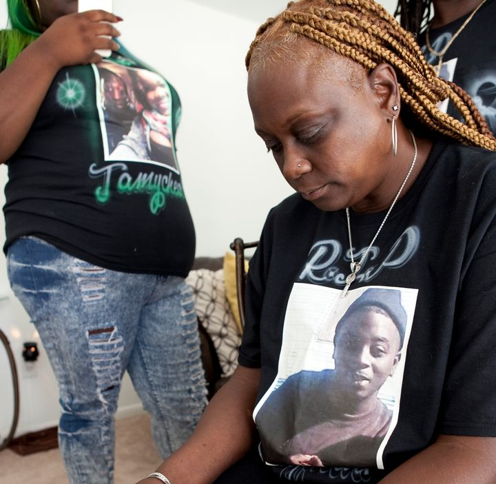 Members of Jamycheal Mitchell's family, wearing shirts with his photograph, pose for a portrait at the home of his aunt in Ch
