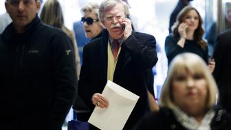John Bolton, former U.S. ambassador to the United Nations (UN), talks on a mobile device while walking through the lobby at Trump Tower in New York, U.S., on Friday, Dec. 2, 2016. Six years after the biggest overhaul of U.S. health care in half a century, the industry is bracing for more change under President-elect Donald Trump, who wants to tear it apart. Photographer: Justin Lane/Pool via Bloomberg