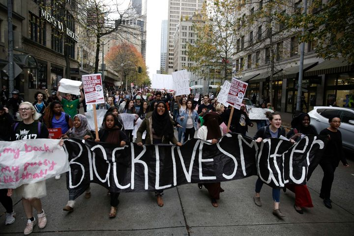 "Protestors carry a ""Black Lives Matter"" banner in Seattle during a student walkout protest following Trump's election, N"