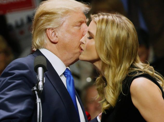 Donald Trump gives his daughter a kiss after she spoke for him at a rally in New Hampshire in early