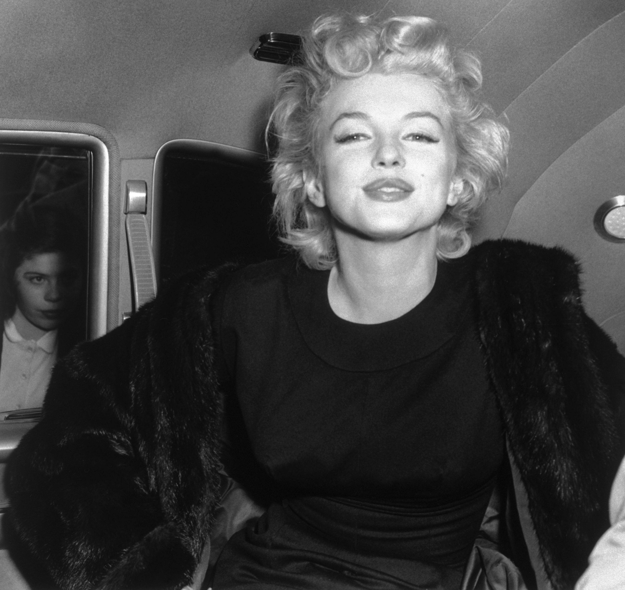 (Original Caption) 6/2/1956-New York, NY: Marilyn Monroe after her arrival at Idlewild Airport from the west coast. Shortly after her 30th birthday.