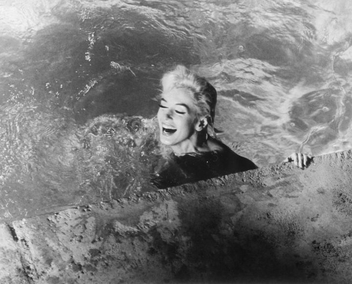 "Marilyn Monroe, playing Ellen Arden, swims naked in ""Something's Got to Give."" The movie was never completed due to Monroe's"