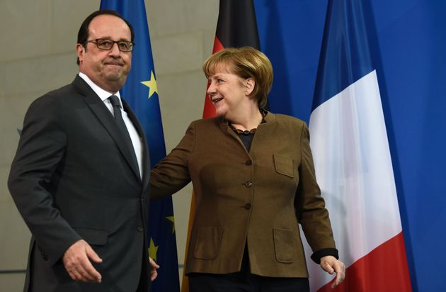French President Francois Hollande and German Chancellor Angela Merkel during a joint press conference...
