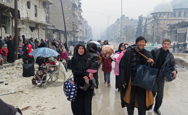 Pro-Assad forces fire on convoy leaving east Aleppo - rescue workers