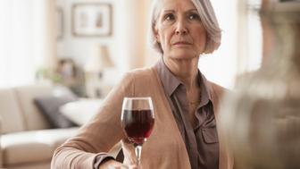 Senior Caucasian woman with glass of wine
