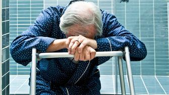 Exhausted Senior with Walking Frame at Rehab