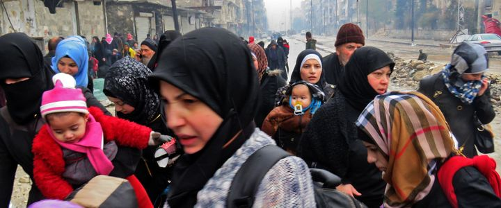 Syrian residents, fleeing violence in the restive Bustan al-Qasr neighborhood, arrive in Aleppo's Fardos neighborhood on&nbsp