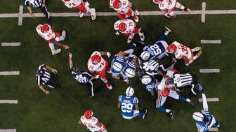 INDIANAPOLIS, IN - OCTOBER 30: A umpire gets into the pile to look for a fumble recovery during the NFL game between the Kansas City Chiefs and Indianapolis Colts on October 30, 2016, at Lucas Oil Stadium in Indianapolis, IN.  (Photo by Zach Bolinger/Icon Sportswire via Getty Images)