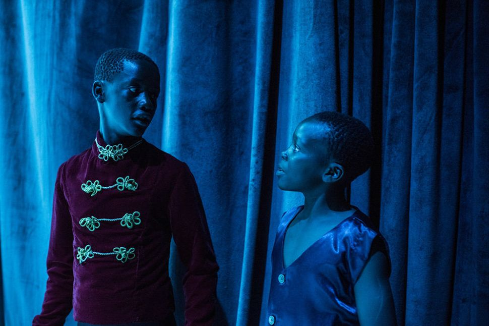 "George and Shamick watching the show backstage during rehearsal for ""The Nutcracker"" at Nairobi National Theatre."