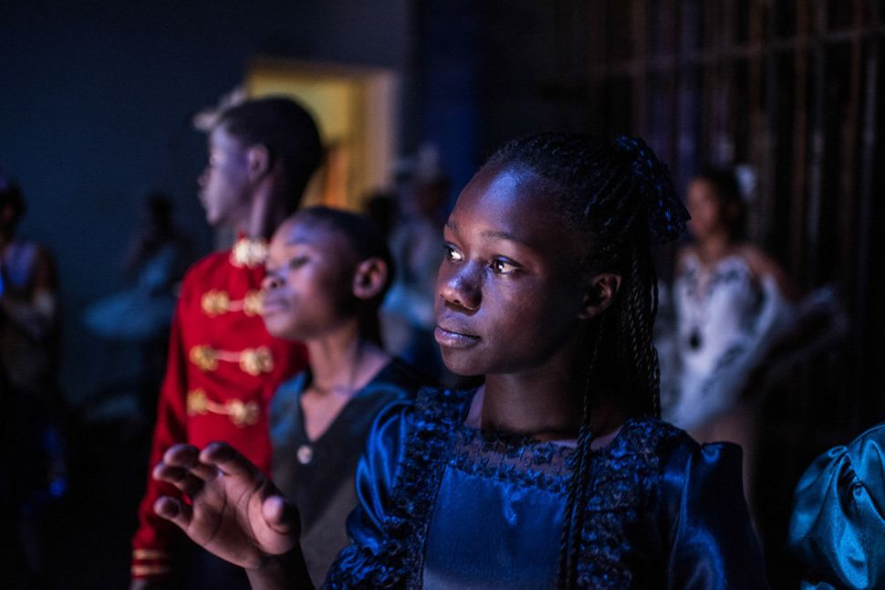 Pamela is watching and waiting for her turn to enter the stage during rehearsal at the national theatre in Nairobi.