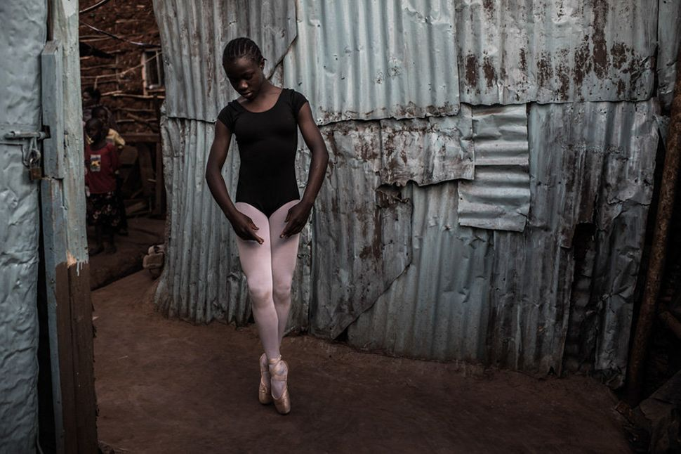 Pamela practicing ballet outside her family's house in Kibera.