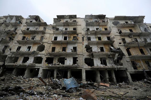Damaged buildings are seen in the government-held al-Shaar neighborhood of Aleppo, during a media tour,...