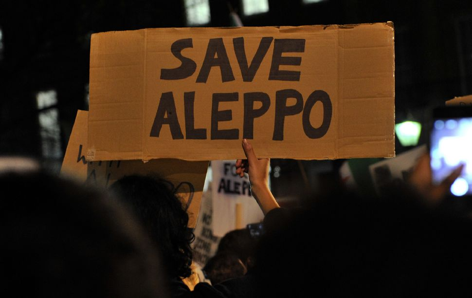 "A ""Save Aleppo"" sign at the protest in London."