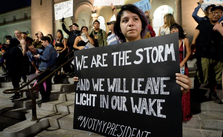 A protestor holds a sign during a rally against the election of Republican Donald Trump as President of the United States in