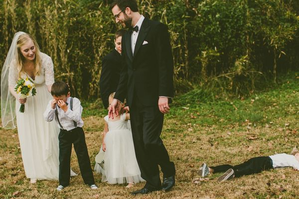 """""""This is our favorite photo of all time. The ring bearers were tired, hungry and didn't want to be in any more formal portrai"""