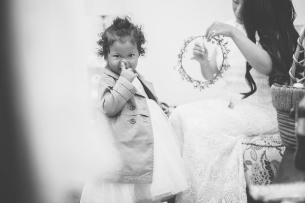 """""""This little flower girl is'doing what she's gotta do' as the bride puts her flower crown on."""" -- <i>Craig Obrist"""