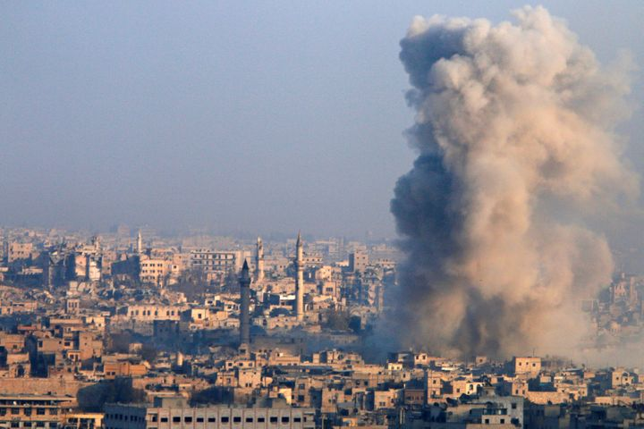 Smoke and debris fill the air amid the siege of Aleppo.