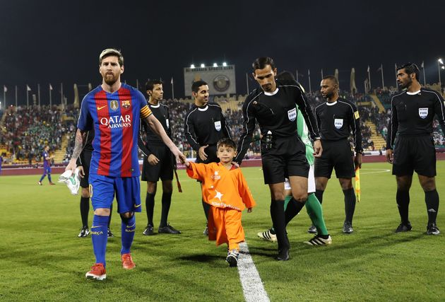 Murtaza Ahmadi takes to the pitch with his hero Lionel