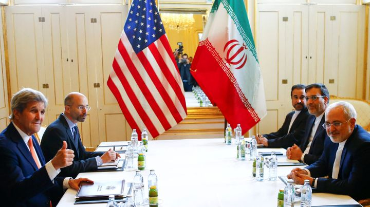 U.S. Secretary of State John Kerry, left, and Iran Foreign Minister Mohammad Javad Zarif attend a bilateral meeting in Vienna