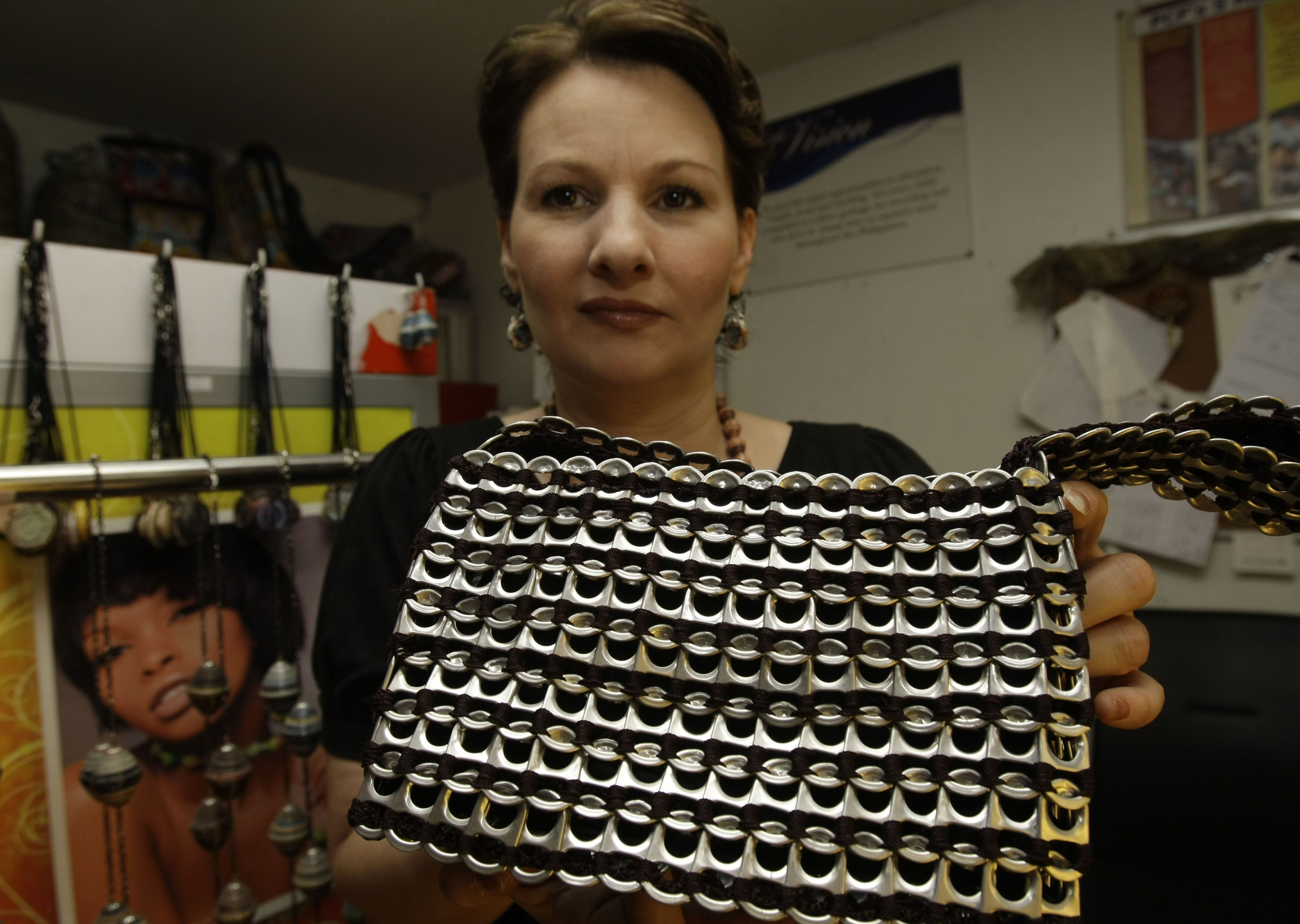 Jane Walker MBE holding one of therecycled products now assembled by prisoners in the