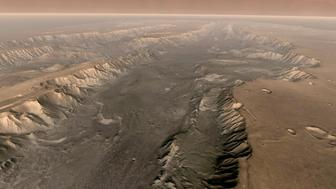 VALLES MARINERIS, MARS  - Mars' own Grand Canyon, Valles Marineris, is shown on the surface of the planet in this composite image made aboard NASA's Mars Odyssey spacecraft. The image was taken from a video featuring high-resolution images from Arizona State University's Thermal Emission Imaging System multi-band camera on board the spacecraft. The mosaic was then colored to approximate how Mars would look to the human eye. Valles Marineris is 10 times longer, five times deeper and 20 times wider than Earth's Grand Canyon.  (Photo by NASA/Arizona State University via Getty Images)