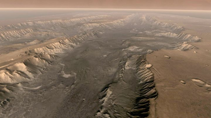 Mars' own Grand Canyon, Valles Marineris, is shown on the surface of the planet in this composite image made aboard NASA's Ma