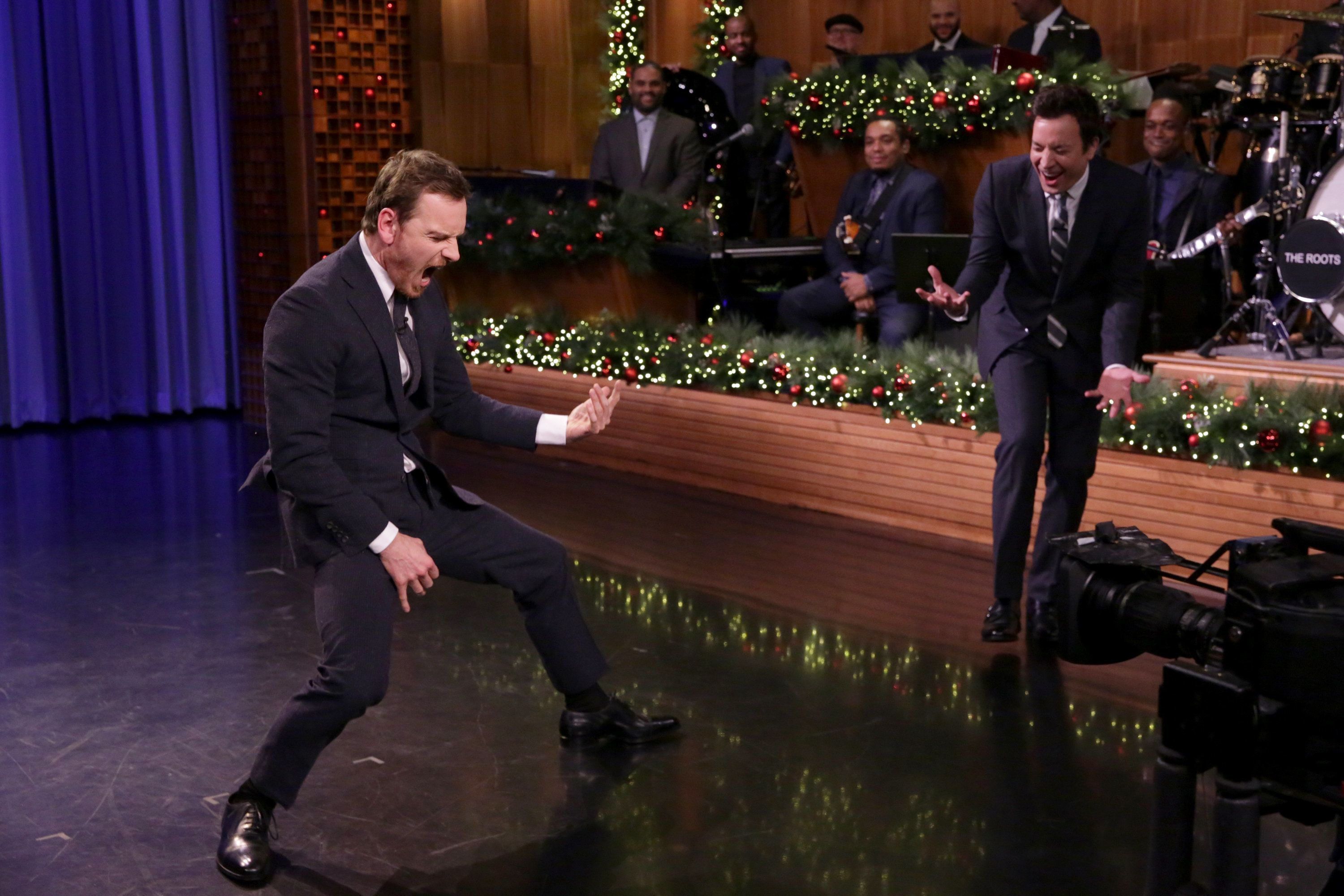 THE TONIGHT SHOW STARRING JIMMY FALLON -- Episode 0590 -- Pictured: (l-r) Actor Michael Fassbender and host Jimmy Fallon have an Air Guitar Battle on December 13, 2016 -- (Photo by: Andrew Lipovsky/NBC/NBCU Photo Bank via Getty Images)