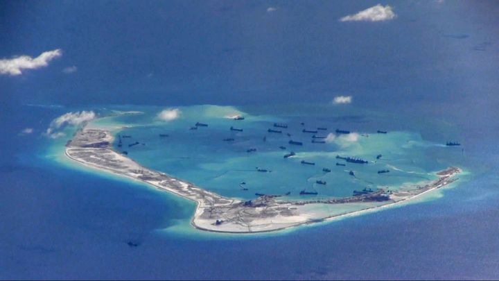 Chinese dredging vessels are purportedly seen in the waters around Mischief Reef in the disputed Spratly Islands in the South