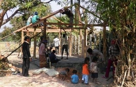 Villagers in rural Cambodia building a Christian community center that Dr. Kuy and her mother supports