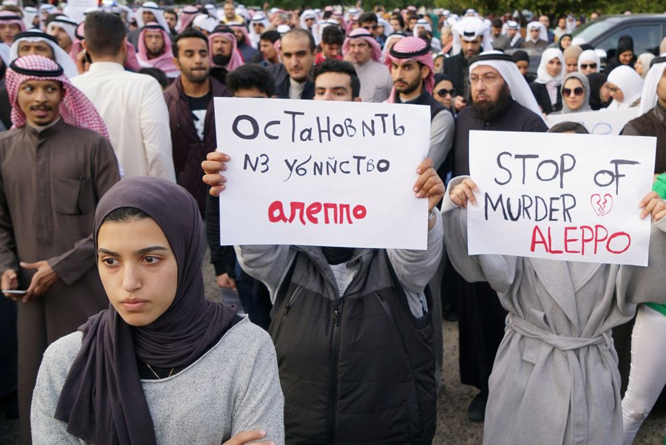 Demonstrators in Shaab, Kuwait, protest outside of the Russian Embassy compound on Dec. 14, 2016.