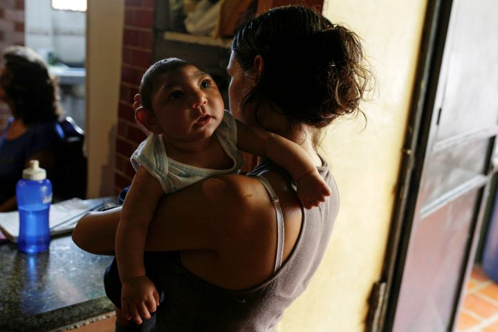 Ericka Torres holds her 3-months old son Jesus, who was born with microcephaly, at their home in Guarenas, Venezuela October 5, 2016. Picture taken October 5, 2016.