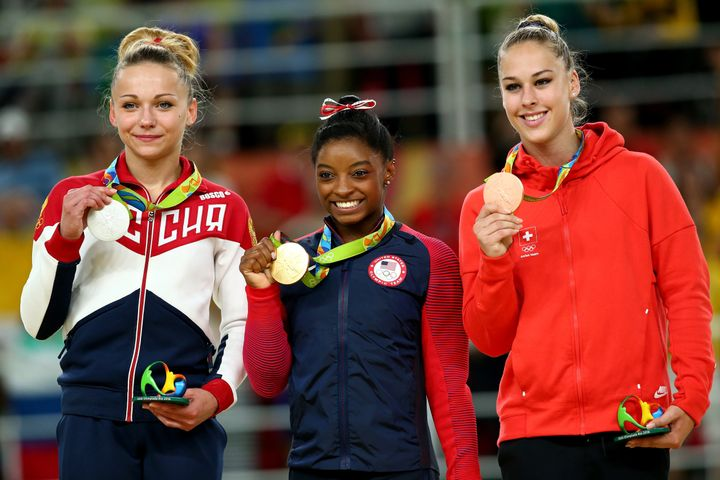 Silver medalist Maria Paseka of Russia, gold medalist Simone Biles of the United States and bronze medalist Giulia Steingrube
