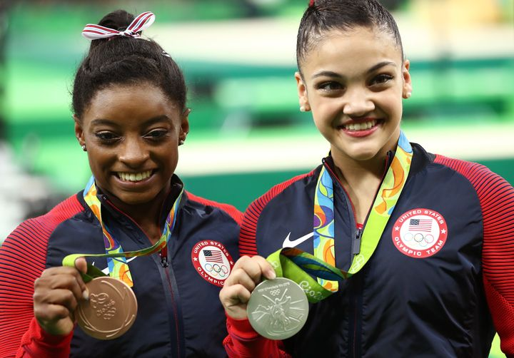 Bronze medalist Simone Biles (L) and silver medalist Lauren Hernandez (R) of the United States pose for photographs after the