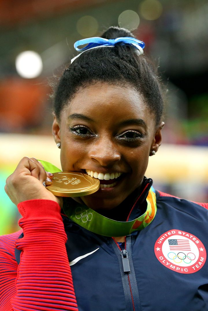 Gold medalist Simone Biles of the United States poses for photographs after the medal ceremony for the Women's Individual All