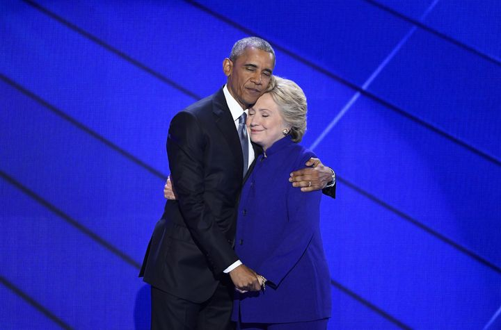 U.S. President Barack Obama hugs Hillary Clinton, 2016 Democratic presidential nominee, on stage during the Democratic Nation